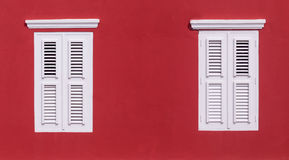 Caribbean Red. A Red Wall with windows and White shutters royalty free stock photography