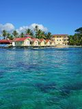 Caribbean resort with cabins over the sea Stock Photos
