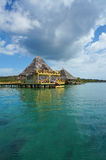 Caribbean resort overwater with thatched roof Royalty Free Stock Image