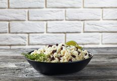 Caribbean Rice and Red Beans in a bowl. Caribbean Rice and Red Beans cooked with coconut milk seasoned with garlic, onions and creole spice in a black bowl with royalty free stock photos