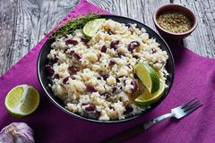 Caribbean Rice and Red Beans in a bowl. Caribbean Rice and Red Beans cooked with coconut milk seasoned with garlic, onions and creole spice in a bowl on a table royalty free stock image