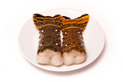 Caribbean rock lobster tails on a white background. Raw Caribbean ( Bahamas ) rock lobster (Panuliirus argus) or spiny lobster tails isolated on a white studio Stock Photos