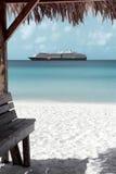 Caribbean sand beach, Bahamas. Caribbean sand beach with cruise ship at the background in Half Moon Cay, Bahamas Stock Photos
