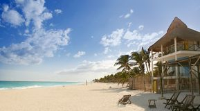 Caribbean sand beach tropical houses in Mexico. Mayan riviera royalty free stock image