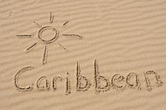 Caribbean in the Sand. A picture of the sun and the word Caribbean drawn in the sand Royalty Free Stock Photography