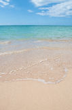 Caribbean Sand shore. Sea shore with soft waves on the sand Royalty Free Stock Image
