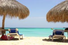 Caribbean sea. Lounge chairs on caribbean sea royalty free stock photos