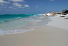 Caribbean Sea Beach. Slight waves at Caribbean Sea and the beach of Cayo Largo del Sur Island Stock Photo
