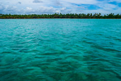 Caribbean sea. And coastline with palm trees in the distance Royalty Free Stock Photo