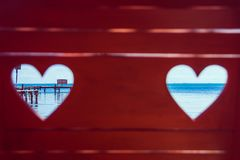 Caribbean Sea through Red Beach Bench Hearts stock photography
