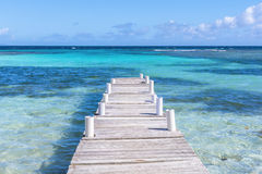 Caribbean sea. Rustic wooden dock at Playa Larga on beautiful Caribbean island of Culebra in Puerto Rico Royalty Free Stock Image