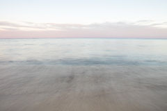 Caribbean Sea. The tide rolls gently in and out on an island beach off the coast of Belize in the Caribbean Sea. This diverse tropical region is a popular Royalty Free Stock Photo