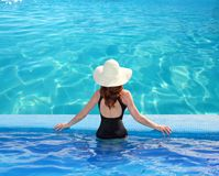 Caribbean sea view from blue pool rear woman Royalty Free Stock Image