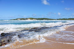 Caribbean sea. Waves splashing on the rocks on a Dominican Republic beach Stock Photography