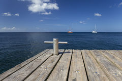 Caribbean sea and wood pier Stock Photo