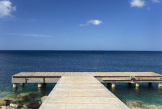 Caribbean sea and wood pier Stock Photography