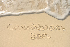 Caribbean Sea Written in Sand on Beach. The Words Caribbean Sea Written in the Sand on a Beach Royalty Free Stock Images