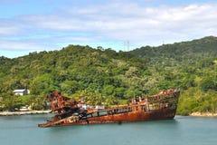 Caribbean shipwreck. Rusty hulk of a shipwreck on the coast of a Caribbean island Royalty Free Stock Photos