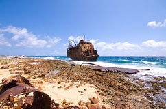 Caribbean shipwreck. Rusty caribbean shipwreck washing ashore on little curacao Stock Images