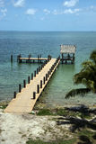 Pier on a Caribbean shore. Stock Photo