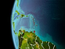 Caribbean from space in evening. Evening over Caribbean as seen from space on planet Earth with visible border lines and city lights. 3D illustration. Elements Royalty Free Stock Photos