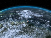 Caribbean from space at night. Satellite night view of Caribbean highlighted in red on planet Earth with clouds. 3D illustration. Elements of this image Royalty Free Stock Images