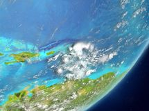 Caribbean from space. Satellite view of Caribbean highlighted in red on planet Earth with clouds. 3D illustration. Elements of this image furnished by NASA Royalty Free Stock Photography