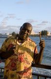 Caribbean Steel Drummer. A caribbean steel drummer posing with his drumsticks Royalty Free Stock Photos
