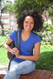 Caribbean student sitting in a park Royalty Free Stock Photo