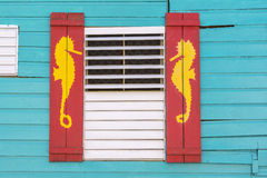 Caribbean style window with sea horse design Royalty Free Stock Image