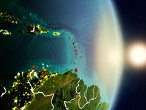 Caribbean during sunrise. Highlighted in red on planet Earth with visible country borders. 3D illustration. Elements of this image furnished by NASA Royalty Free Stock Image