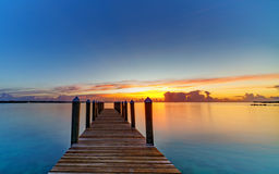 A Caribbean sunrise from a dock. A Caribbean sunrise view from a dock Royalty Free Stock Photo