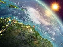Caribbean in sunrise from orbit. Sunrise above Caribbean highlighted in red on model of planet Earth in space. 3D illustration. Elements of this image furnished Stock Photography