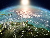 Caribbean in sunrise from orbit. Sunrise above Caribbean highlighted in red on model of planet Earth in space with visible country borders. 3D illustration Stock Photo