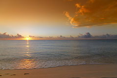 Caribbean sunrise over beach Stock Photos