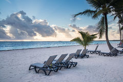 Caribbean Sunrise. On sandy beach with palm trees Stock Images