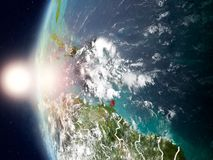 Caribbean during sunset on Earth. Satellite view of Caribbean highlighted in red on planet Earth with clouds and visible country borders during sunset. 3D Royalty Free Stock Photography