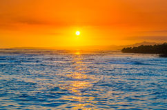 Caribbean sunset. Sunset on Caribbean sea, rocky island Stock Images