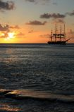 Caribbean sunset and ship Stock Photos