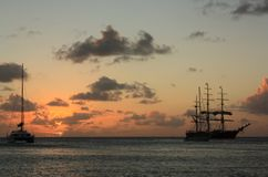 Caribbean sunset and ship Royalty Free Stock Photography