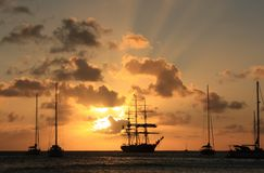 Caribbean sunset and silhouett of the ship Stock Photo