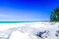 View on woman relaxing on Caribbean tropical beach by Palomino in Colombia royalty free stock photos