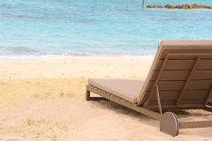 Sand beach with parasol and Sunbeds. Caribbean tropical sand beach with parasol and Sunbeds Royalty Free Stock Photos