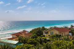 Caribbean tropical style houses on sea shore. Cancun, Mexico Royalty Free Stock Photos