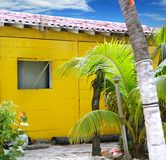 Caribbean tropical yellow beach wooden house Royalty Free Stock Photo