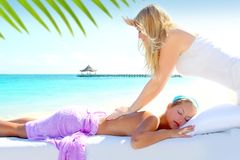Caribbean turquoise beach massage woman. Caribbean turquoise beach chiropractic massage therapy woman stock photography