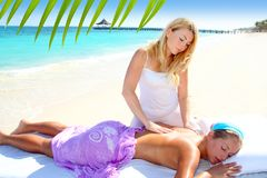 Caribbean turquoise beach massage woman Royalty Free Stock Image