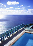 Caribbean View. This is a view looking out over the Caribbean sea from the deck of a swimming pool Stock Photo