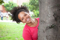 Caribbean woman behind a tree Royalty Free Stock Image