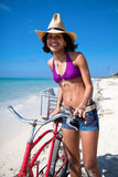 Caribbean woman with bicycle Royalty Free Stock Photography